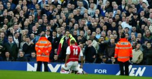 Thierry Henry celebrates his spectacular goal for Arsenal in front of the Tottenham fans.