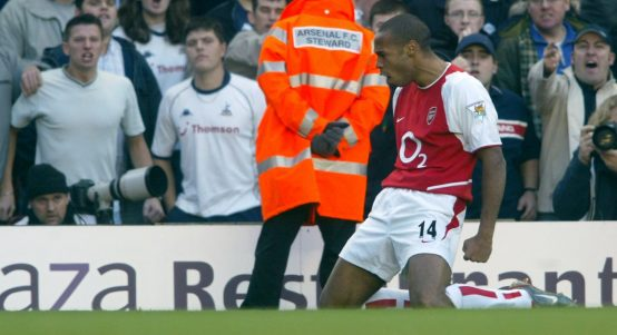 Arsenal's Thierry Henry celebrates in front of the Tottenham fans.