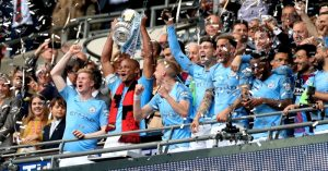 Vincent Kompany lifts the FA Cup