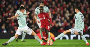 Naby Keita of Liverpool is challenged by James Rodriguez and Robert Lewandowski of Bayern Munich