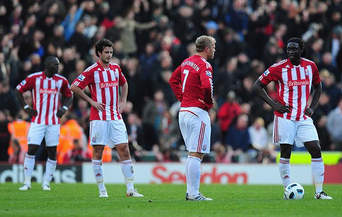 Abdoulaye Faye, Marc Wilson, Eidur Gudjohnsen and Kenwyne Jones look distraught following a late winner by Javier Hernandez