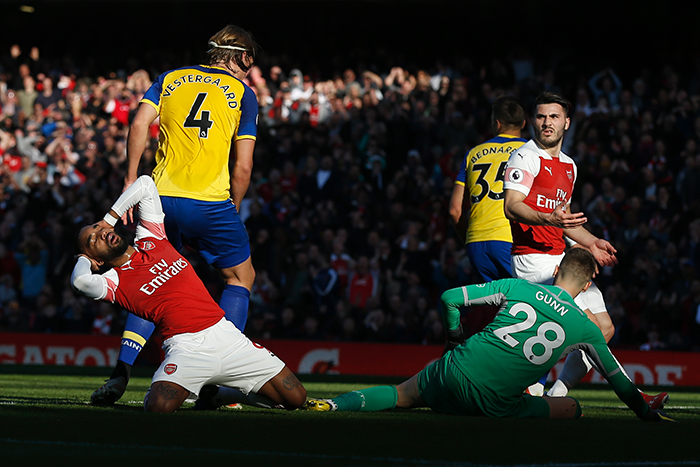 Arsenal's Alexandre Lacazette (L) reacts after missing a shot on goal against Southampton