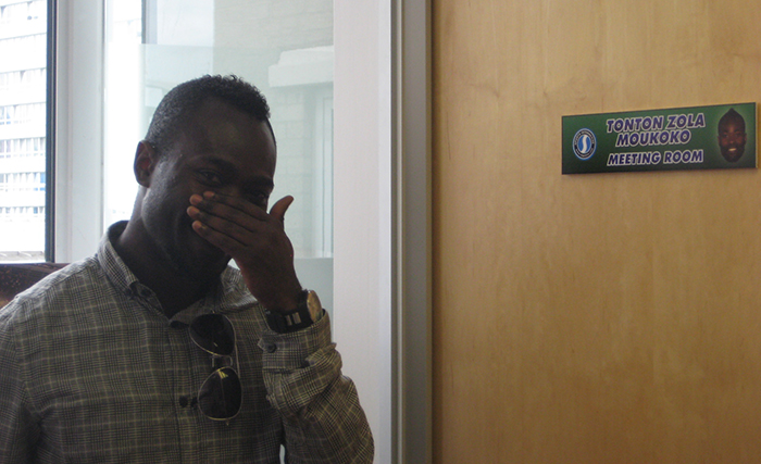 Tonton Zolo Moukoko pictured outside the meeting room named in his honour at Sports Interactive's studios