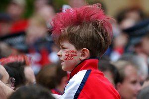 A young Arsenal fan imitates Fredrick Ljungberg's hair