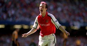 Arsenal's Fredrik Ljungberg celebrates the opening goal against Liverpool