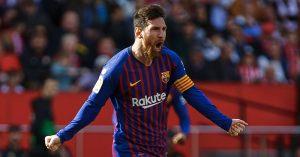 Lionel Messi celebrates scoring for Barcelona vs Sevilla