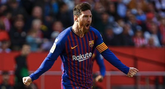 Lionel Messi celebrates scoring for Barcelona vs Sevilla