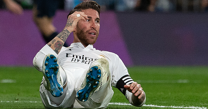 Sergio Ramos of Real Madrid lies on the ground vs FC Barcelona