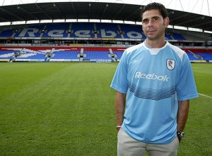 Fernando Hierro poses after signing for Bolton, 2004