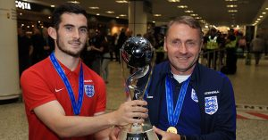 England U20's manager Paul Simpson and captain Lewis Cook (left) arrive at Birmingham Airport with the World Cup