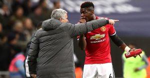 Jose Mourinho and Paul Pogba talk on the touchline