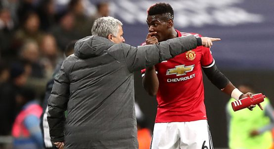 Jose Mourinho and Paul Pogba talk on the touchline