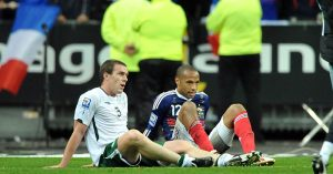 Thierry Henry sits with Richard Dunne
