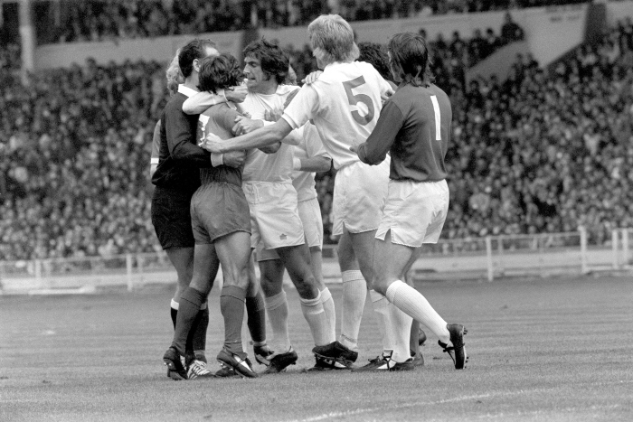 <br /> * Gordon McQueen (Leeds) and David Harvey (Leeds goalkeeper) pictured also trying to calm things down. Bother Keegan and Bremner were sent off.