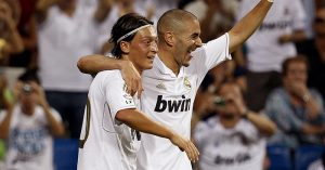 Mesut Ozil and Karim Benzema celebrate