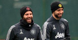 Juan Mata and Bruno Fernandes laugh
