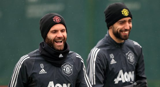 Juan Mata and Bruno Fernandes laugh