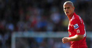 Paul Konchesky makes his Liverpool debut against Birmingham City.