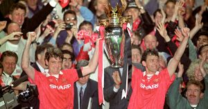 Manchester United's Steve Bruce and Bryan Robson lift the Premier League title.