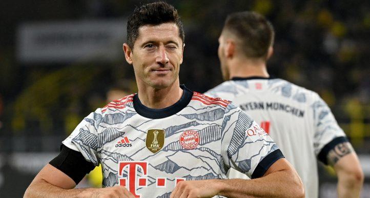 Bayern Munich's Robert Lewandowski celebrates after scoring against Borussia Dortmund in German Super Supercup.