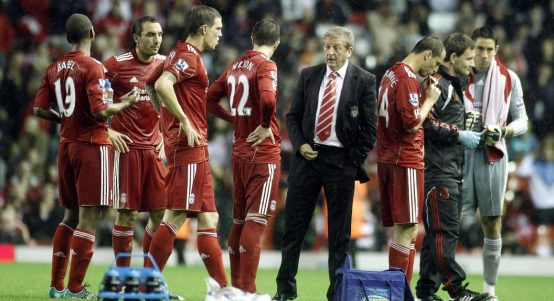 Liverpool manager Roy Hodgson talks to his team prior to the penalty's during the third round Carling Cup match against Northampton.