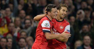 Mesut Ozil celebrates after scoring for Arsenal.
