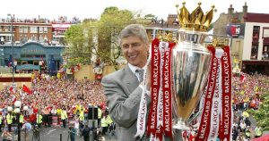 Arsenal manager Arsene Wenger lifts the Premier League trophy.