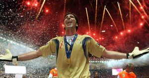 Gianluigi Buffon celebrates with his arms open and fireworks above his head after Italy had won the 2006 World Cup final against France in Berlin, July 2006.