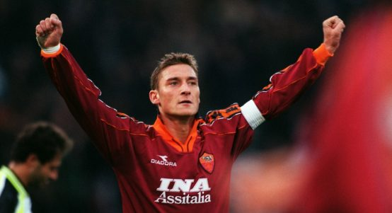 Francesco Totti celebrates scoring for Roma