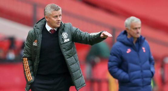 Ole Gunnar Solskjaer and Jose Mourinho on the Old Trafford touchline.