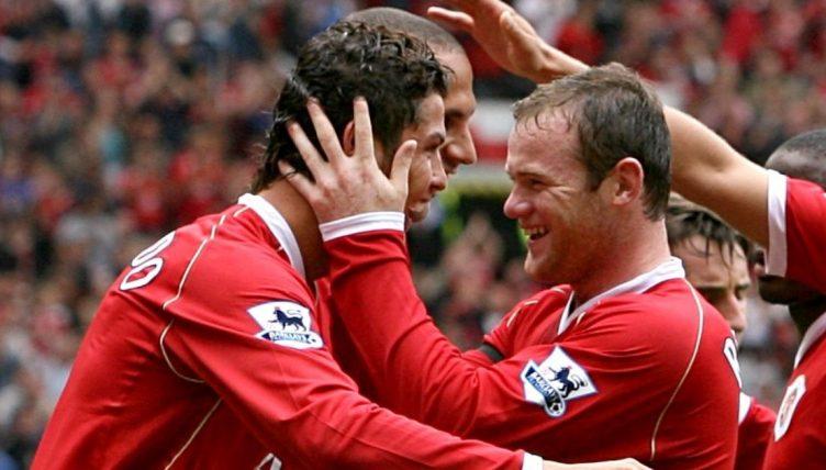 Cristiano Ronaldo celebrates with Wayne Rooney after scoring for Manchester United.