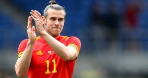 Gareth Bales applauds Wales fans after a friendly game against Albania in Cardiff.