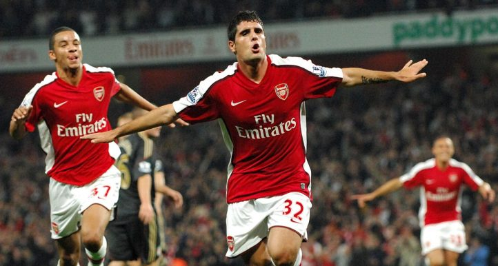 Fran Merida wheel away in celebration, arms spread, after scoring for Arsenal against Liverpool in October 2009.