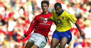 Cristiano Ronaldo and Ashley Cole battle for the ball. Old Trafford, September 2003.