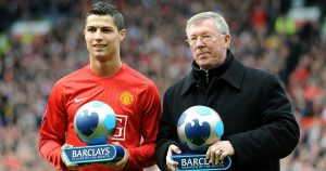 Cristiano Ronaldo and Sir Alex Ferguson hold player and manager of the month trophies at Old Trafford. April 2008.