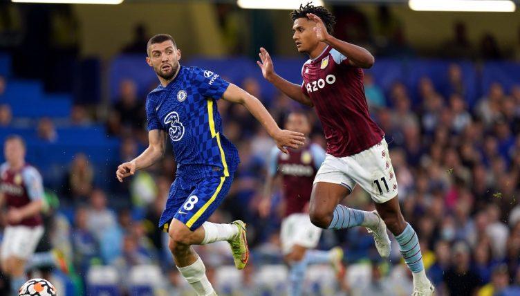 Chelsea's Mateo Kovacic holds off Aston Villa's Ollie Watkins.