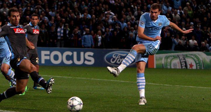 Manchester City's Edin Dzeko has a shot on goal