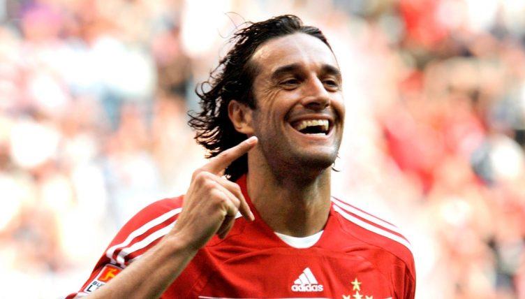 Luca Toni celebrates scoring for Bayer Munich in April 2009