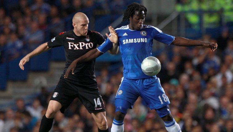 Chelsea striker Romelu Lukaku battles for the ball with Fulham's Philippe Senderos.