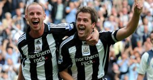 Michael Owen celebrates after scoring for Newcastle United.