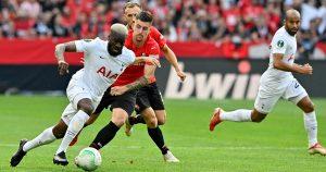 Tanguy Ndombele protects the ball from Baptiste Santamaria as Tottenham Hotspur draw against Stade Rennais. Roazhon Park.