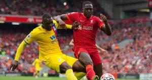 Liverpool's Ibrahima Konate battles for the ball with Christian Benteke.