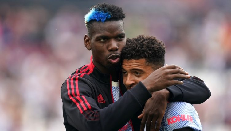 Paul Pogba and Jadon Sancho celebrate after Manchester United win.