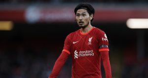 Takumi Minamino looks for the ball as Liverpool face Norwich City.