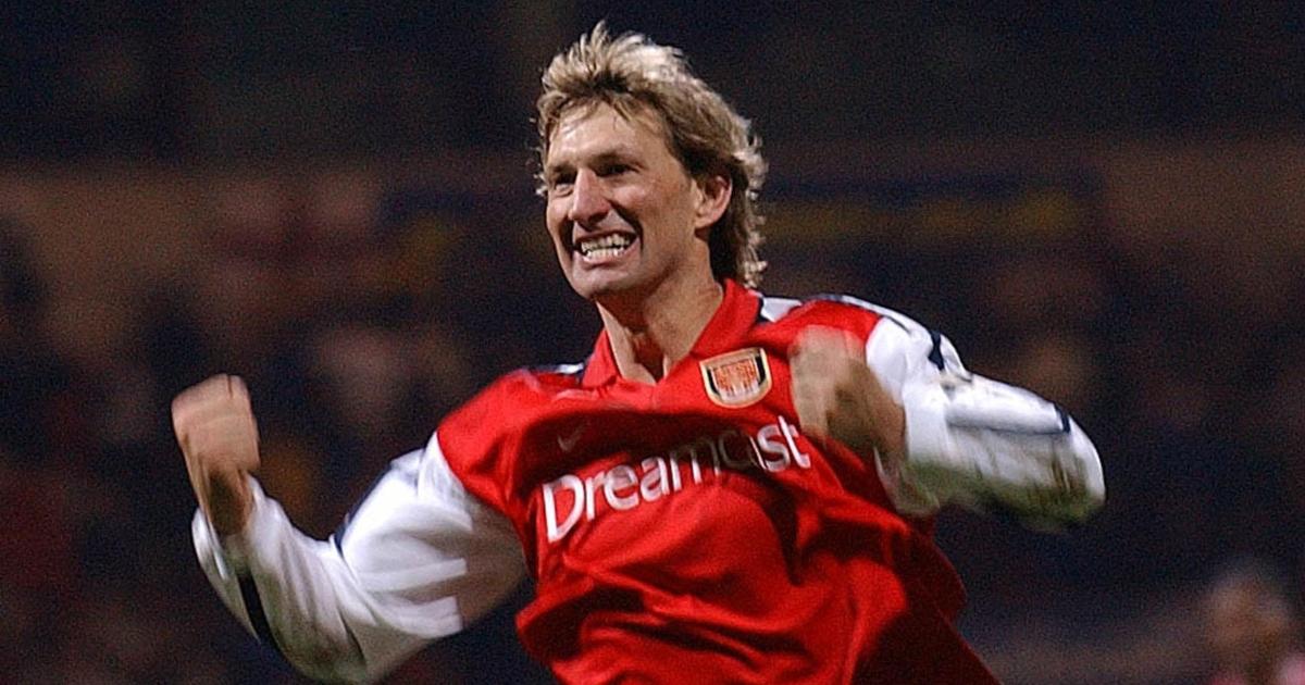 Watch: Tony Adams celebrates next to a glum Ledley King during Arsenal win - Planet Football