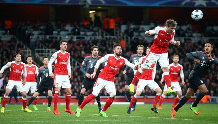 Arsenal's Nacho Monreal wins a header