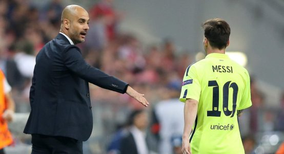 Pep Guardiola talks to Lionel Messi during Bayern Munich's game with Barcelona.