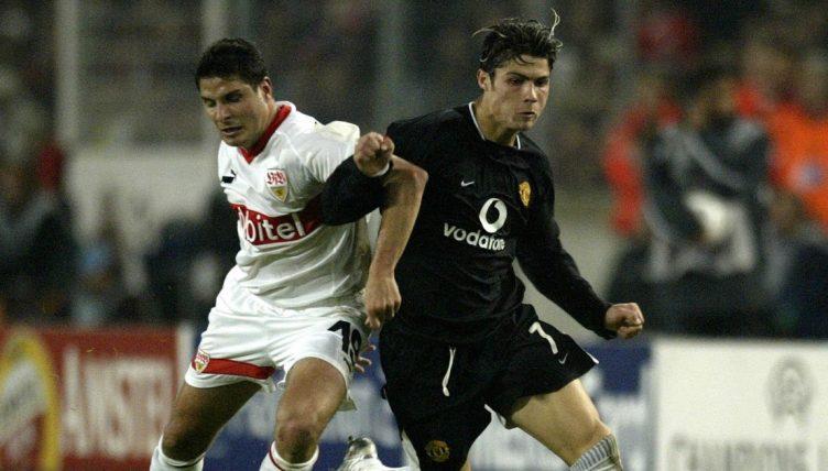 Manchester United's Cristiano Ronaldo battles past the challenge from Stuttgart's Imre Szabics.