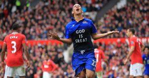 Steven Pienaar celebrates scoring for Evertona gainst Manchester United, revelaing a 'God is Great' t-shirt. April 2012.