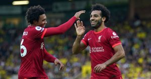 Liverpool's Mohamed Salah celebrates with Trent Alexander-Arnold after scoring against Norwich.